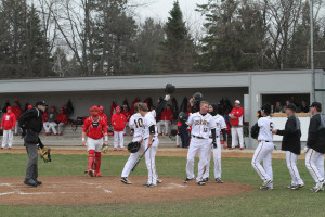 The Gusties celebrate after a home run. (photos by Alex Nadeau, Gustavus Sports Information)