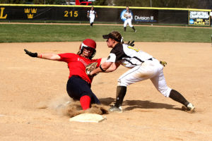 Kaitlyn Bicek tags a Saint Mary's runner out at third base. (photos courtesy of Laura Westphal, SPX Sports)