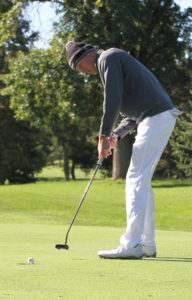 Ben Hauge drains a putt on the No. 2 green Monday at Le Sueur Country Club.