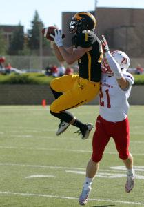 Josh Kirk makes a leaping catch. (photo by AJ Dahm, SPX Sports)