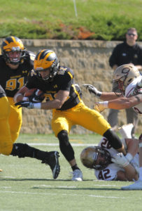 Jamison Beulke extends for extra yards. (photo by Wayne Norman, SPX Sports)