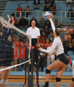 Carly Thompson goes up for a kill.