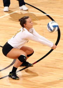 Brittany Luethmers digs out an attack. (photo by AJ Dahm, SPX Sports)