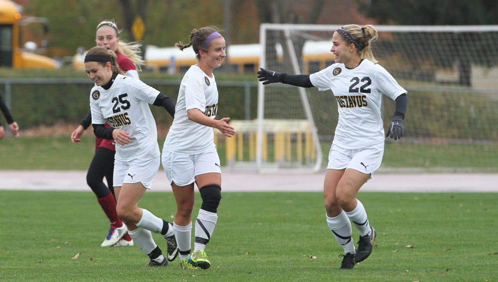 Sophie Leininger (center) celebrates with teammates. Leininger led the Gusties with two goals and an assist.