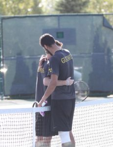Alhouni (right) and Whaling embrace following the singles final.