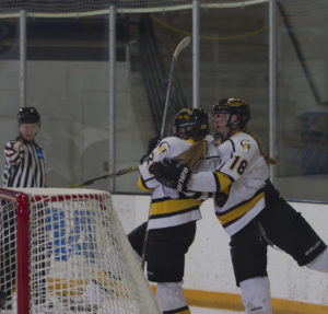 Kaitlyn Klein and Allie Stanger celebrate the game-tying goal. (Kegan Couture)