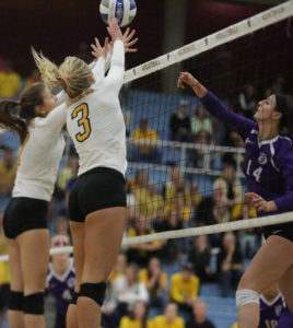 Sam Haugen (7) and Taylor Trautman (3) go up for a block against St. Thomas' Whitney Lloyd.