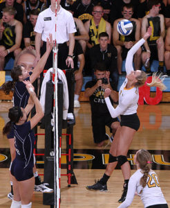 Taylor Trautman connects for a kill against Bethel. (AJ Dahm photo)